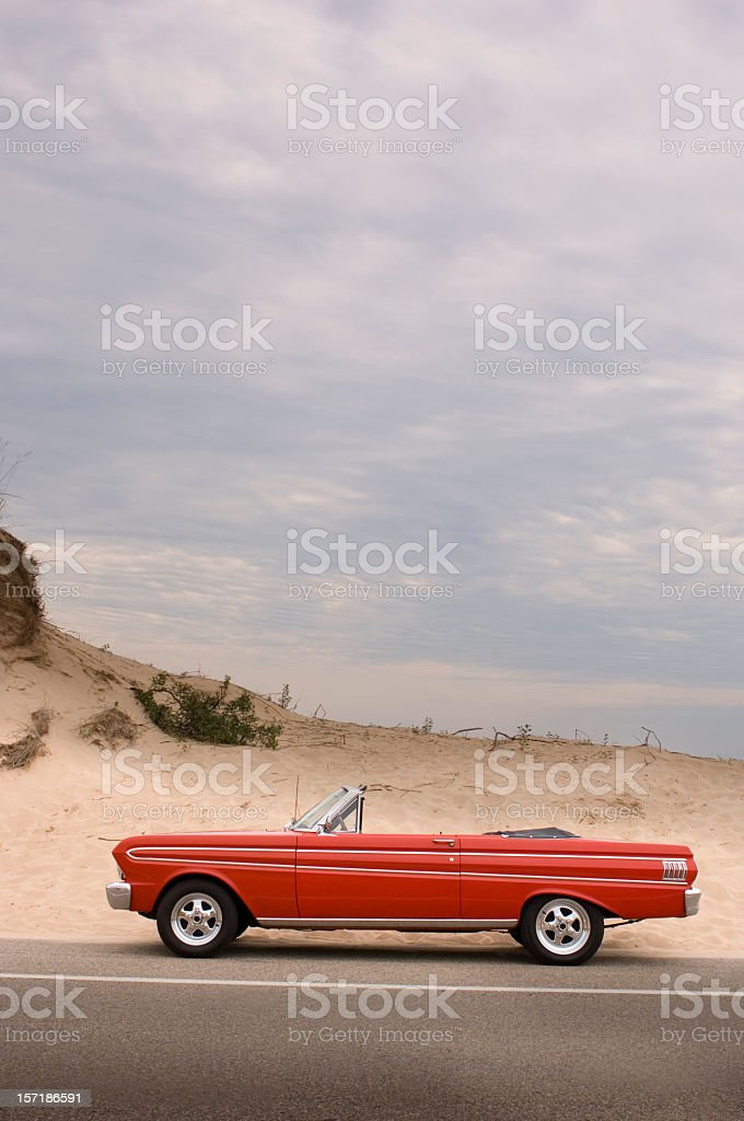 Classic red convertible in the desert - scenic royalty-free stock photo