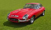 Classic Red E - Type Jaguar in vintage car Show.