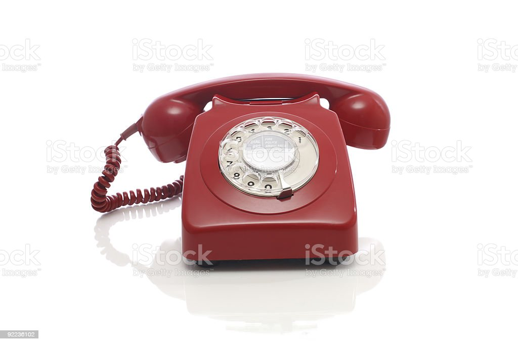 Classic Red Plastic Rotary Dial Telephone Receiver On White royalty-free stock photo