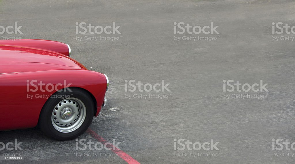 Classic red sports car at start line stock photo