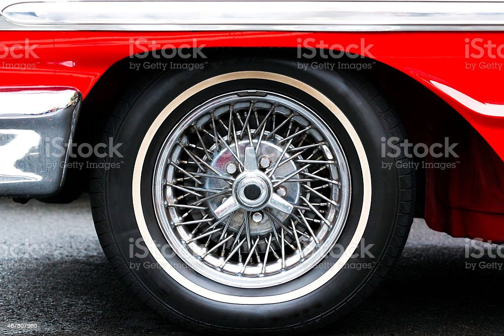 Classic red sports car wire wheel chrome finish stock photo