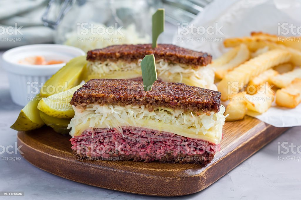 Classic reuben sandwich, served with dill pickle, potato chips, horizontal stock photo