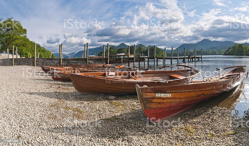 Classic row boats on idyllic lake shore royalty-free stock photo
