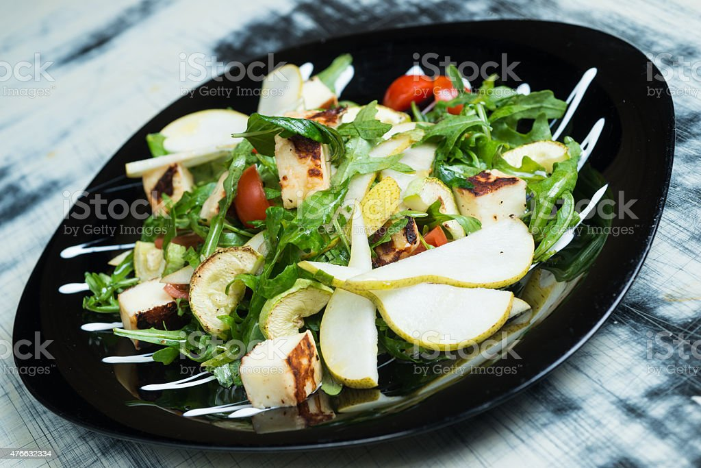 Classic salad with pear, arugula or rocket leaves stock photo