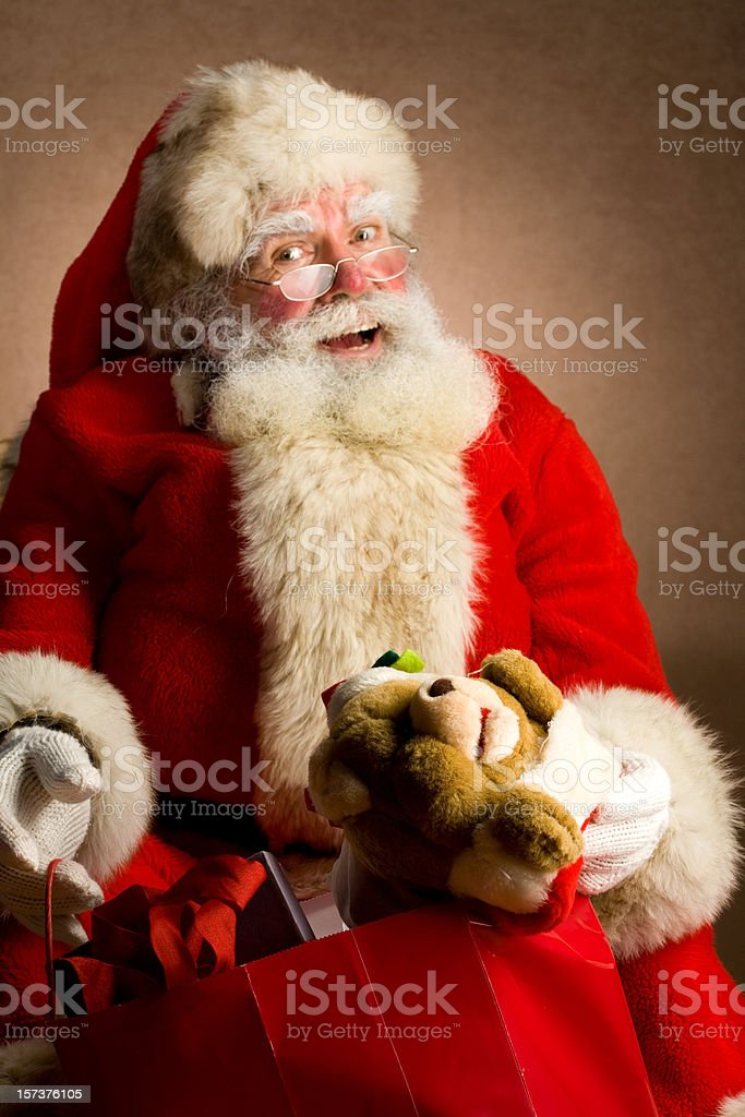 Classic Santa holding a bag of gifts stock photo