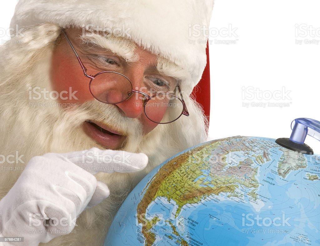 Classic Santa looking at Northern America. royalty-free stock photo