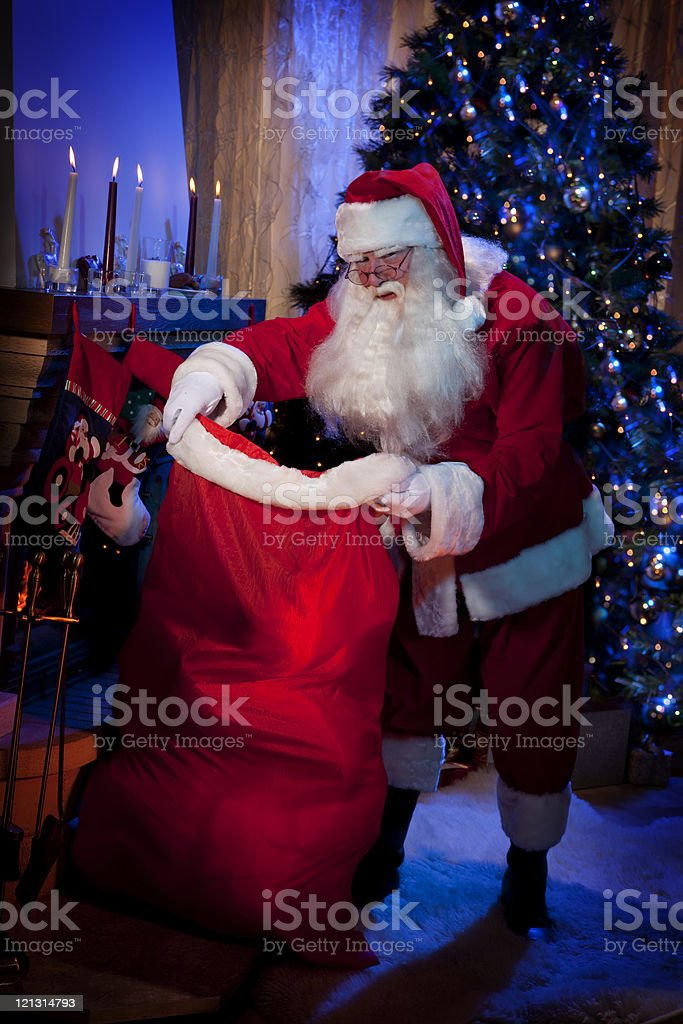 Classic Santa standing with a bag of Presents. royalty-free stock photo