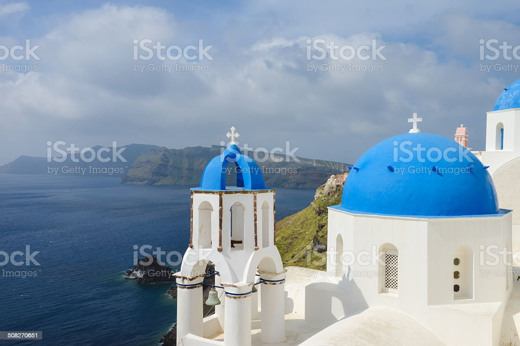 Classic Santorini scene with famous blue dome churches royalty-free stock photo