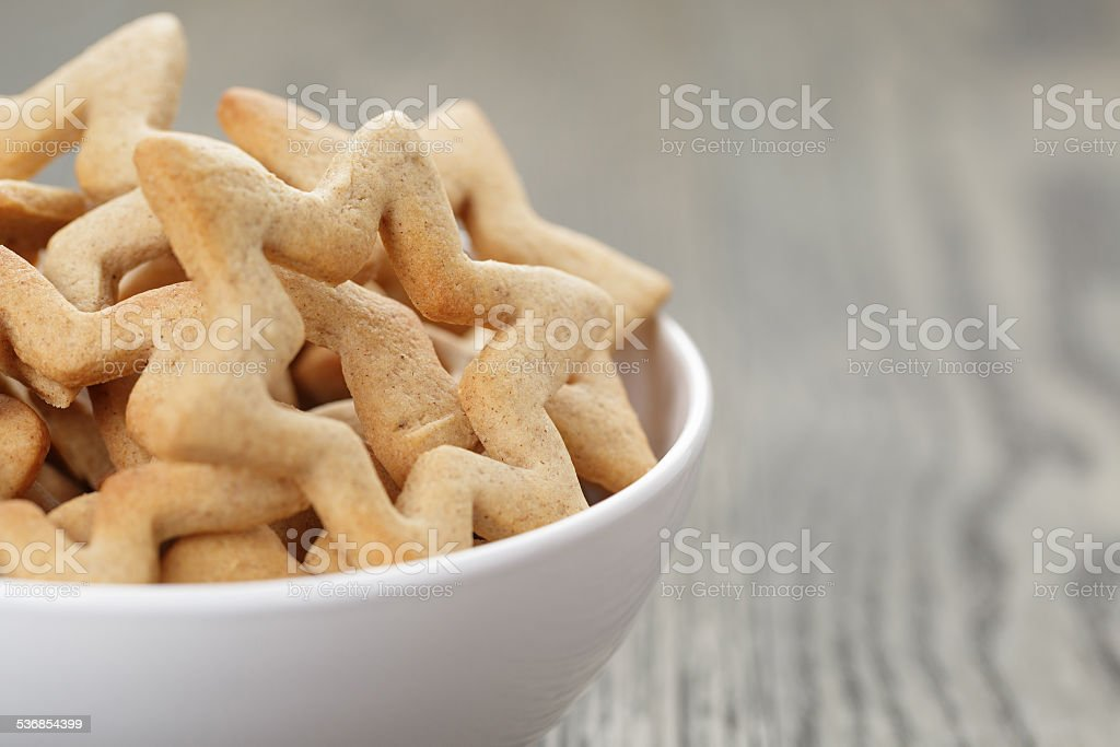 classic star cookies in white bowl stock photo