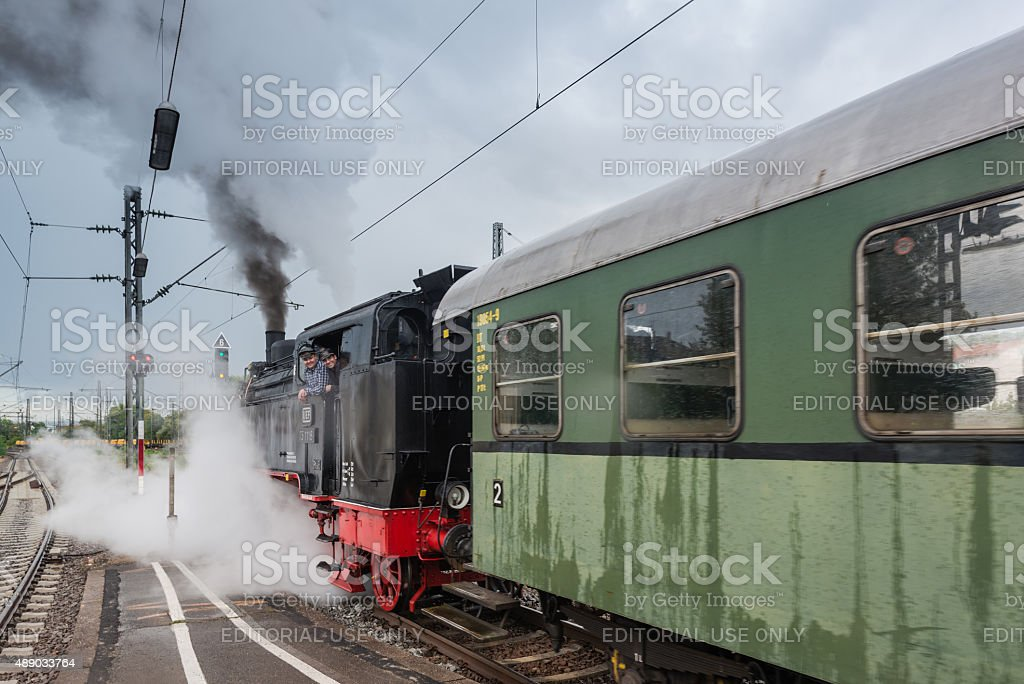 classic steam locomotive with waggon starting engines stock photo