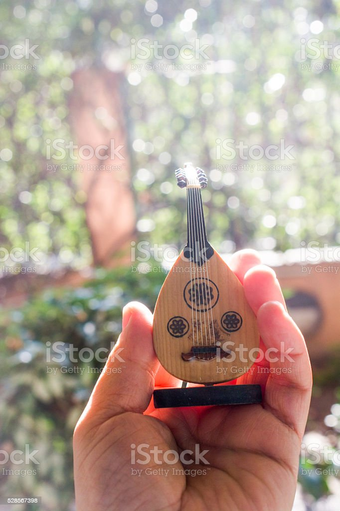Classic stringed musical instrument Ud in hand stock photo