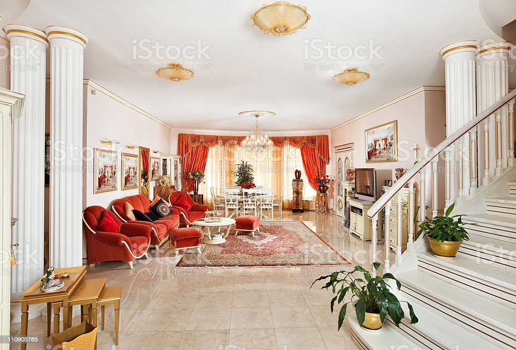Classic style drawing-room interior in red and golden colors stock photo