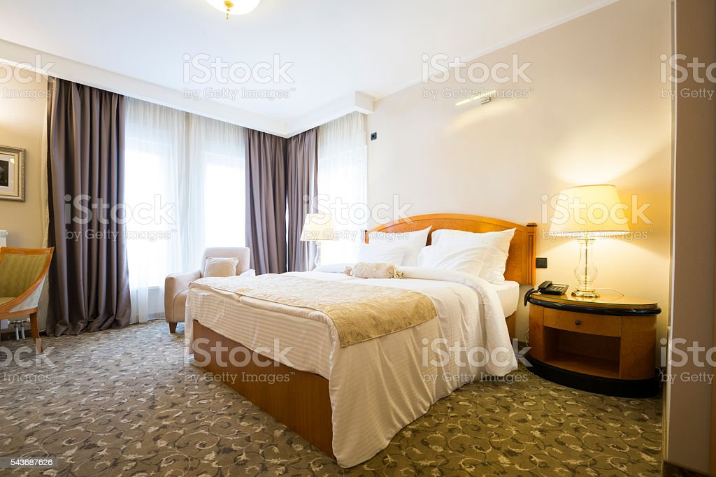 Classic style hotel bedroom interior stock photo