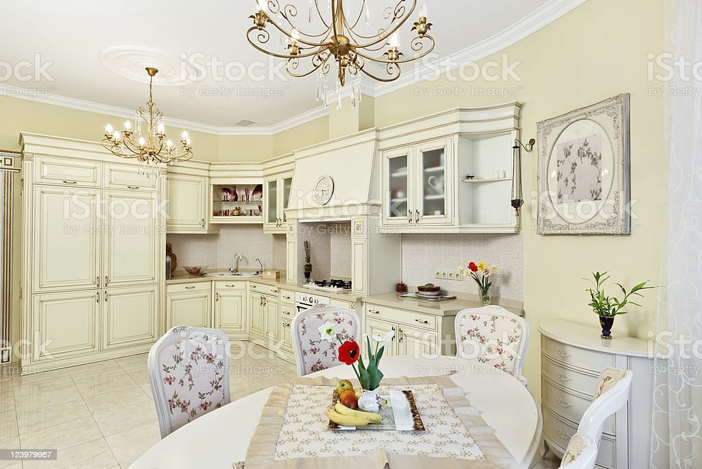 Classic style kitchen and dining room interior in beige royalty-free stock photo