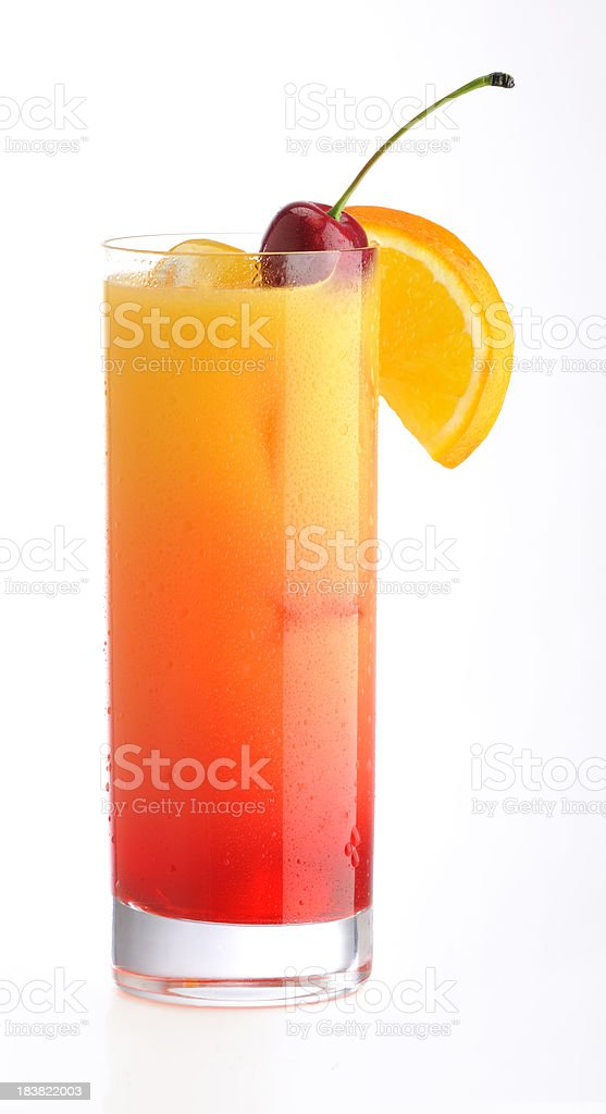 Classic Tequila Sunrise cocktail with cherry & orange slice on ice royalty-free stock photo