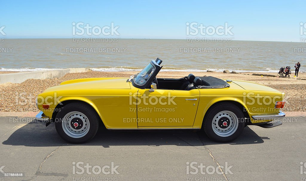 Classic Triumph TR6 on the seafront. stock photo