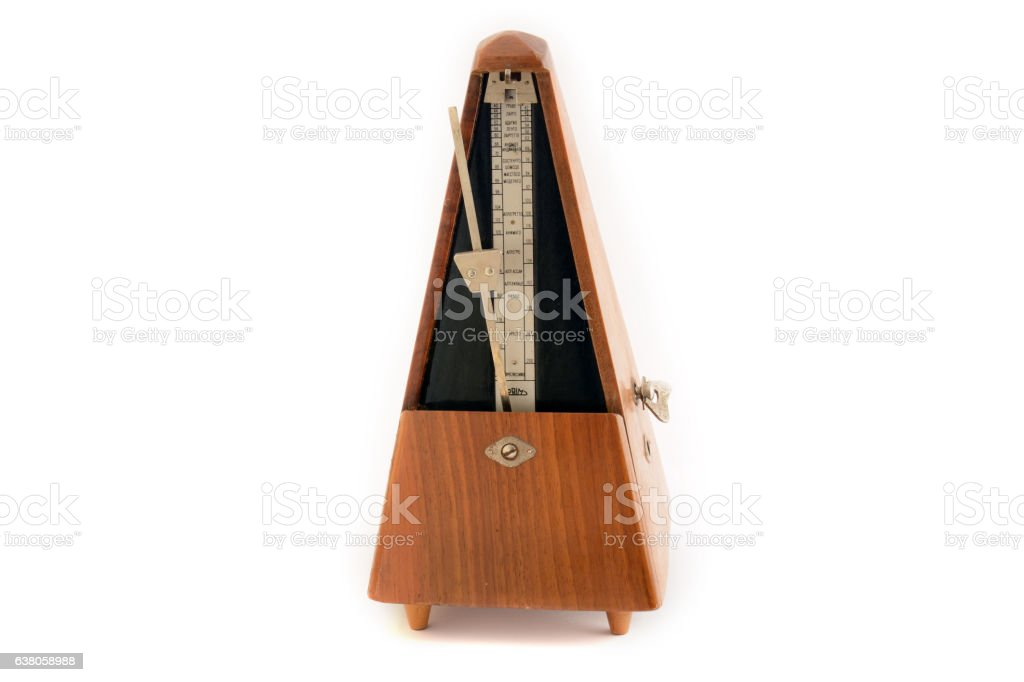 Classic vintage wooden metronome in motion stock photo