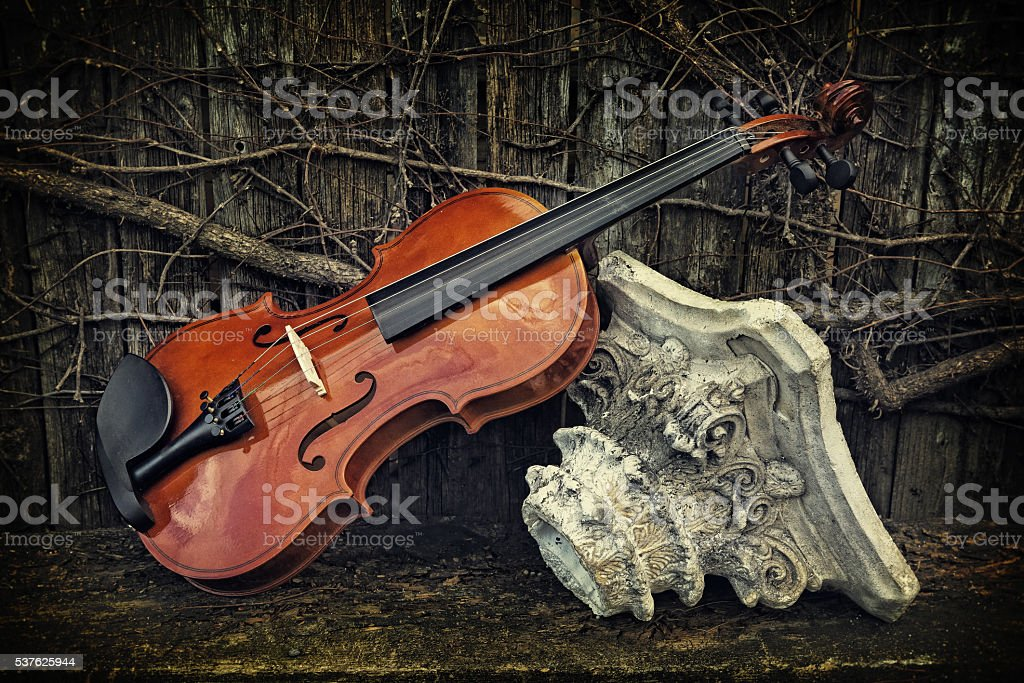 Classic Violin - Violin on Wooden Shelf with Roman Column stock photo