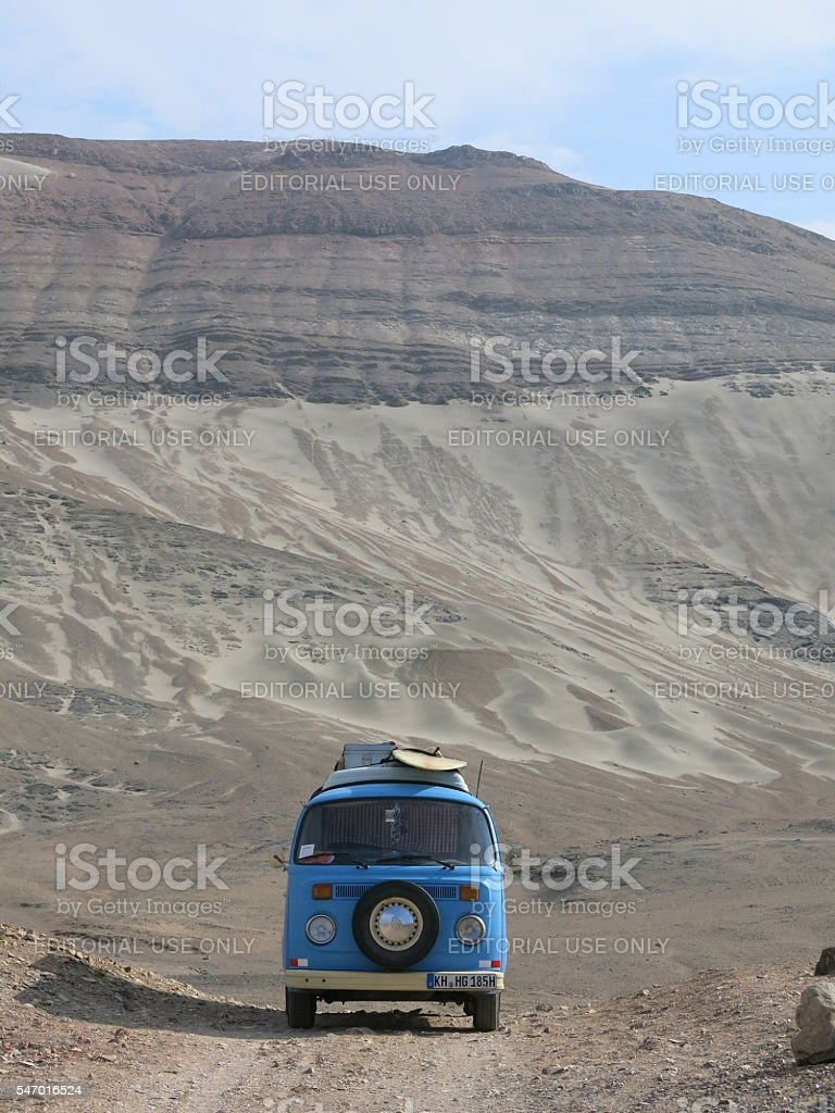 Classic VW Bus stopped at  dirtroad in peruvian desert stock photo