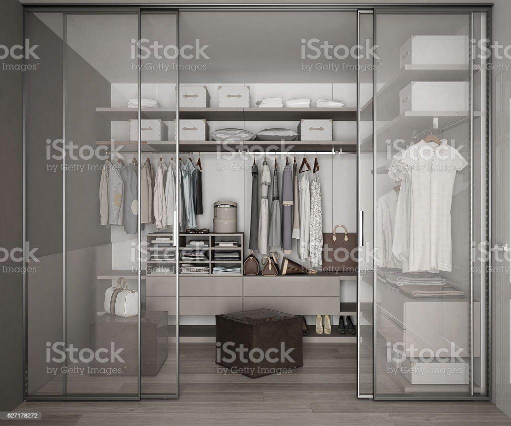 Classic walk in closet with glass sliding doors stock photo