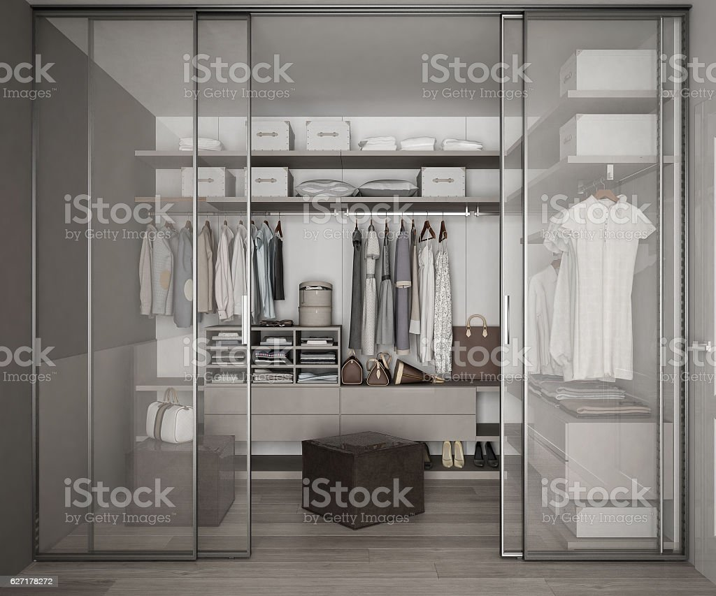 Classic walk in closet with glass sliding doors stock photo