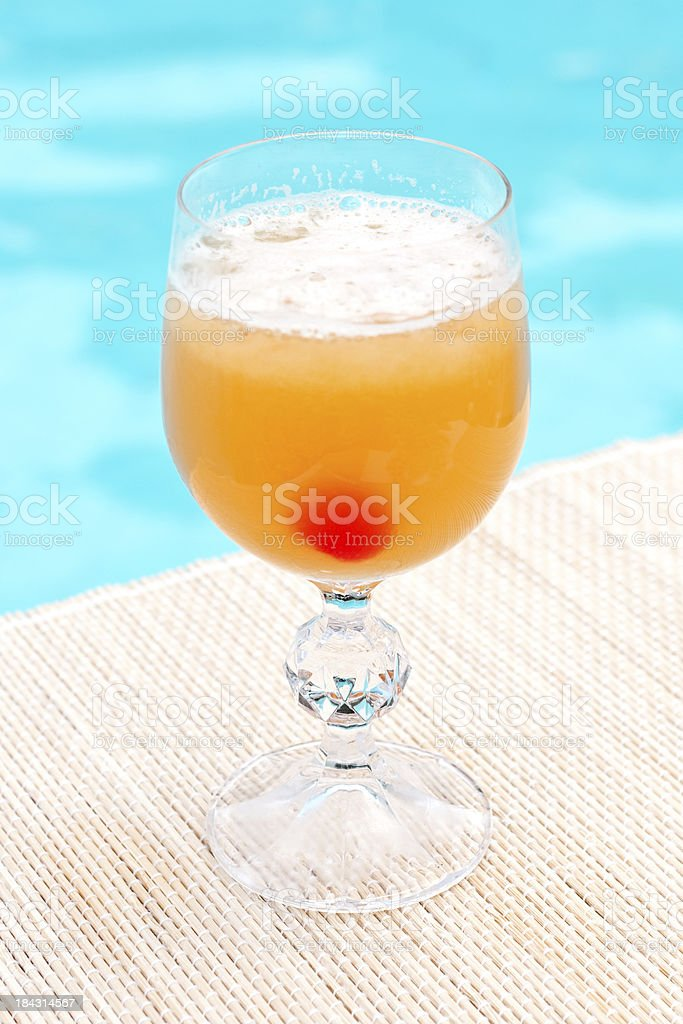 Classic Whiskey Sour cocktail near waterpool on the mat stock photo