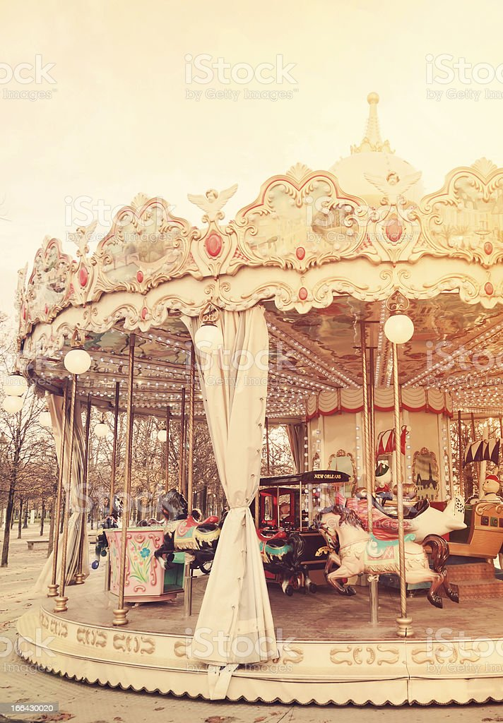 A classic white carousel awaits the next group of passengers stock photo