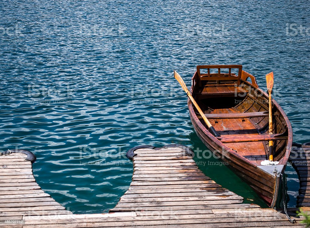 Classic Wooden Traditional Rowing Boat at a Jetty royalty-free stock photo