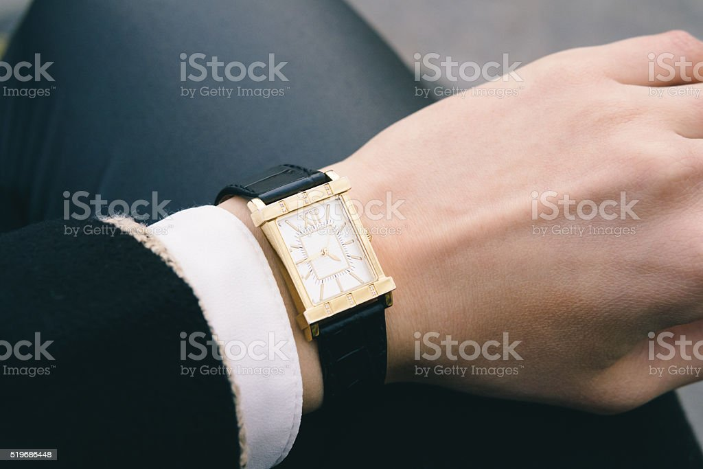 Classic wrist watch on a female hand closeup stock photo