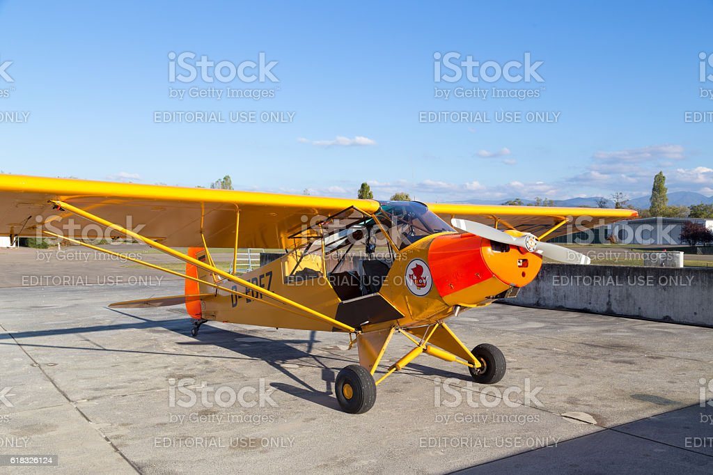 Classic yellow Piper Cub aircraft stock photo