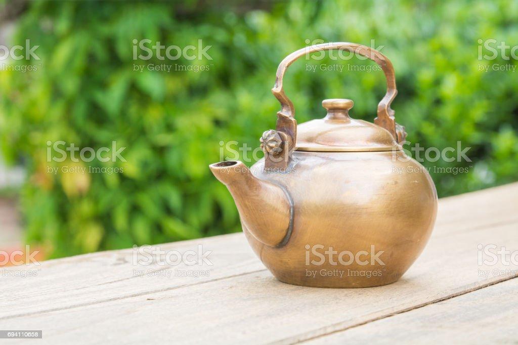 Classical asian teapot at outdoors stock photo