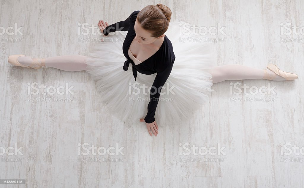 Classical Ballet dancer in split portrait, top view stock photo