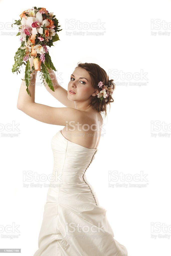 Classical bride is throwing the bouquet stock photo