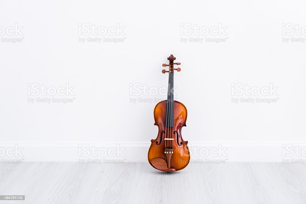 Classical cello on white wall background stock photo