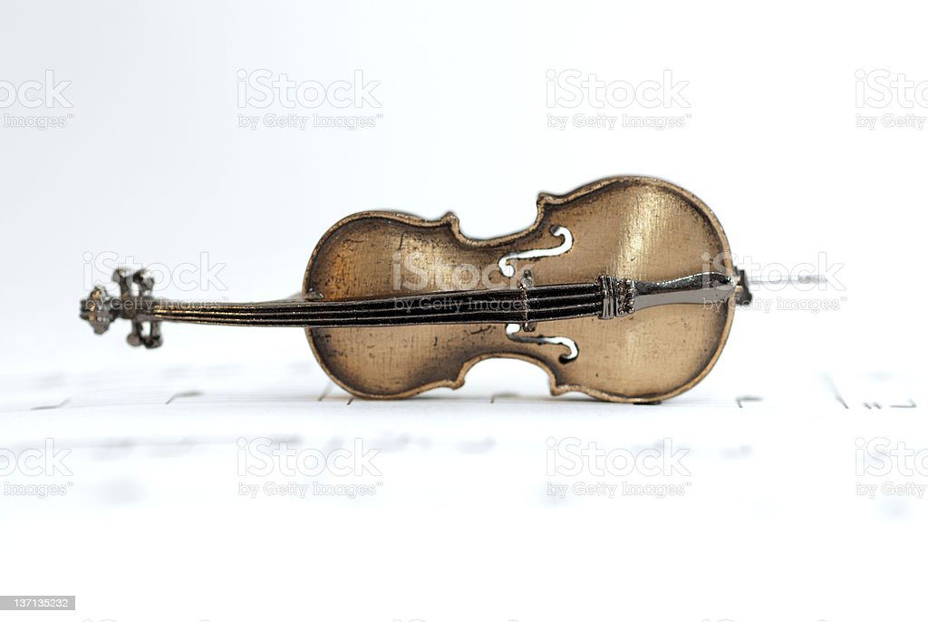 Classical Cello Placed On Music Sheet royalty-free stock photo