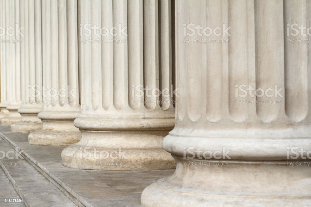 Horizontal perspective view close up of classical building marble...