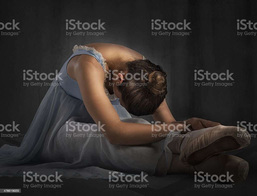Classical dancer stretching stock photo
