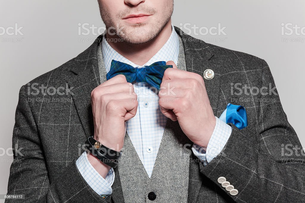 Classical elegance, man wearing tweed jacket and bow tie stock photo