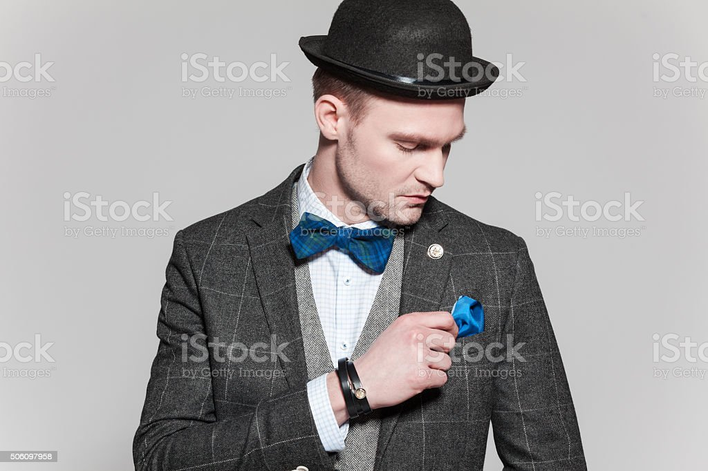 Classical elegance, man wearing tweed jacket, bow tie and bowler stock photo