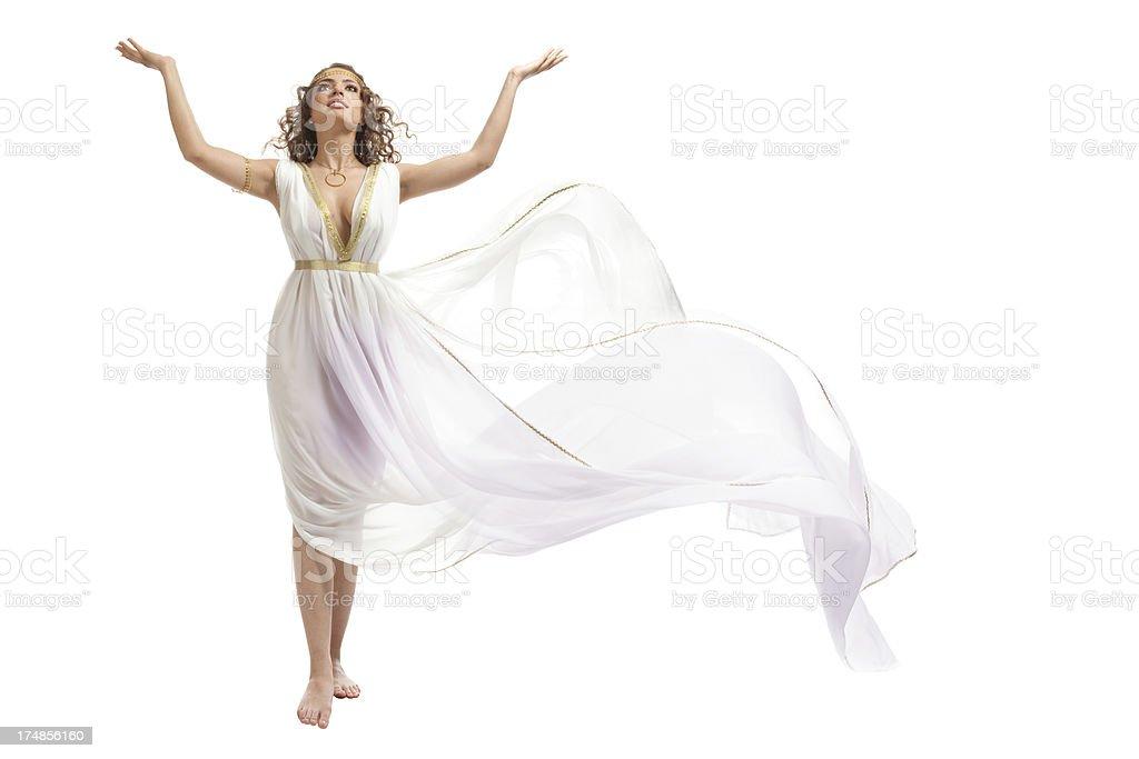 Classical Greek Goddess in Tunic Raising Arms stock photo
