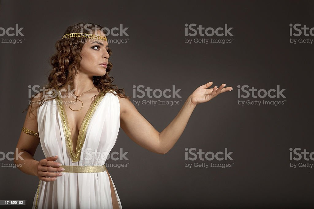 Classical Greek Goddess in Tunic Showing Something stock photo