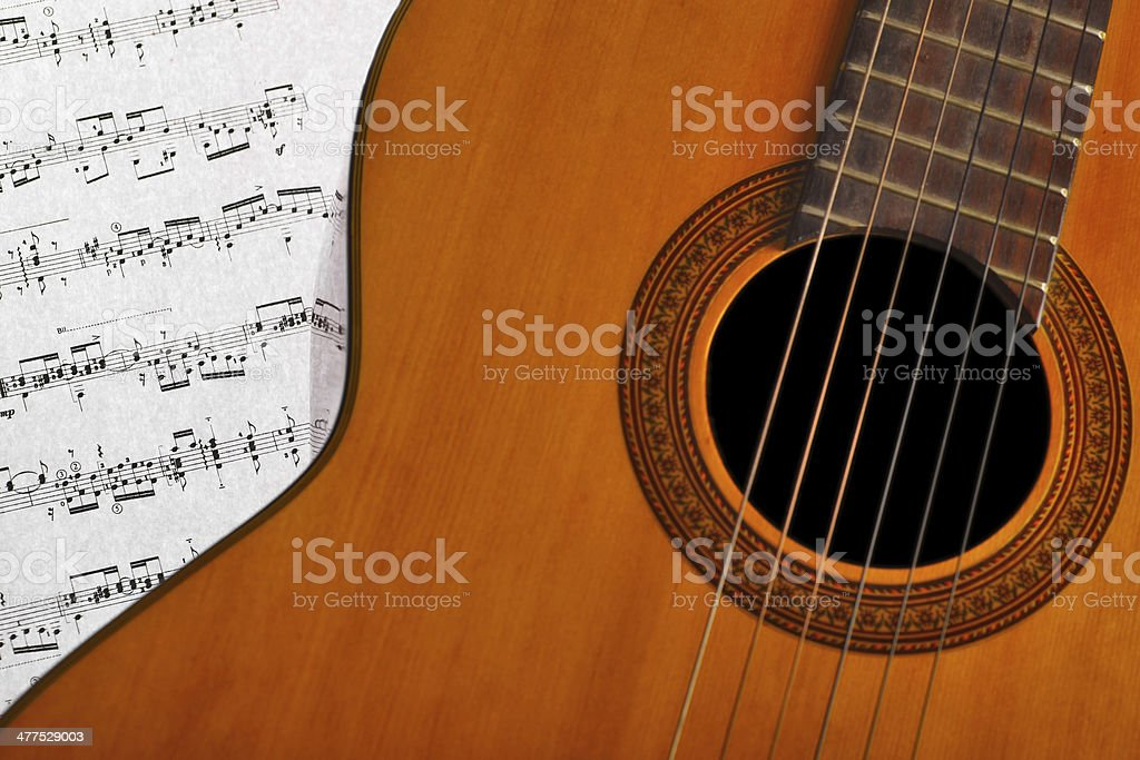 Classical guitar and notes royalty-free stock photo