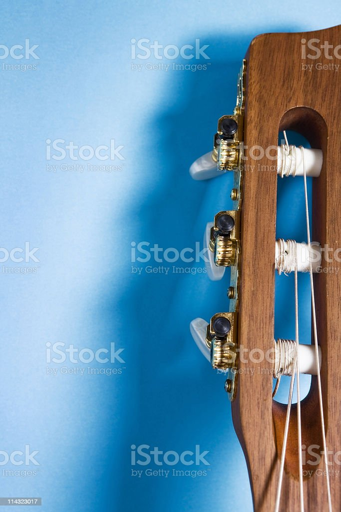 Classical guitar headstock on blue stock photo