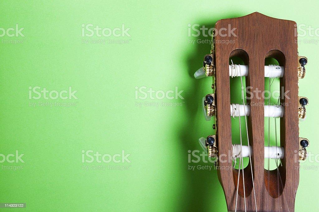 Classical guitar headstock on green stock photo