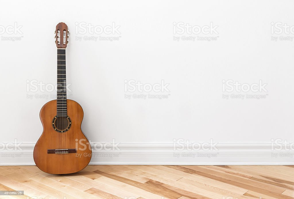 Classical guitar in an empty room stock photo