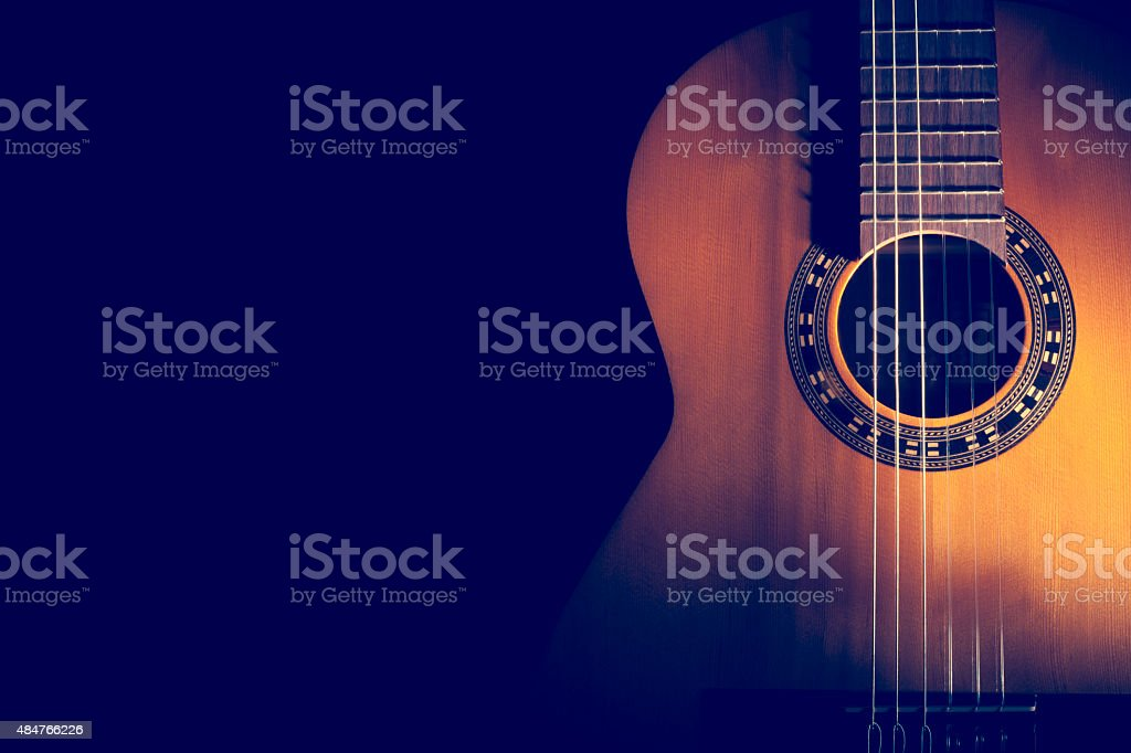 Classical Guitar on a dark background. stock photo