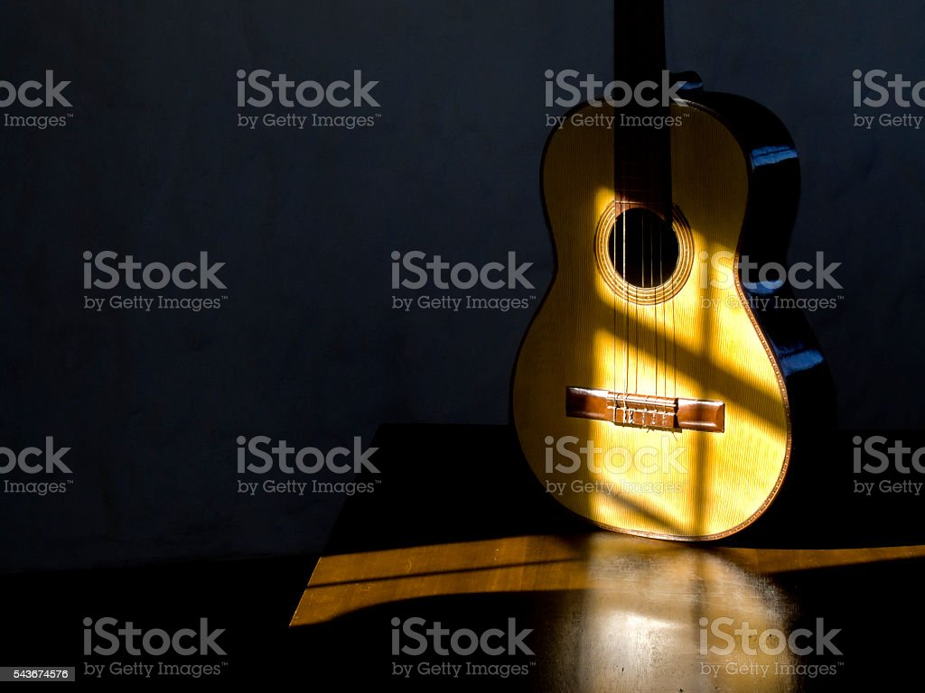 Classical Guitar with shades on the table stock photo