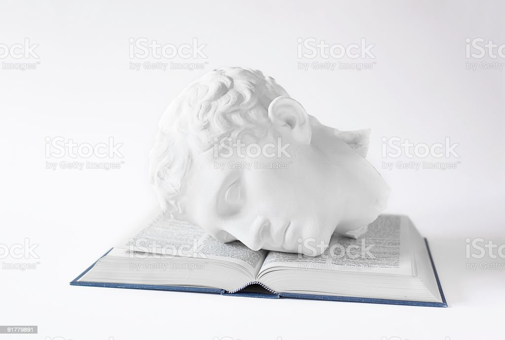 Classical Head on open Book royalty-free stock photo