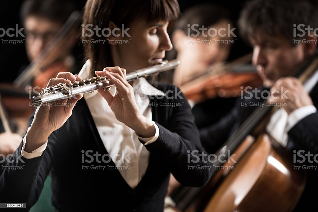 Classical music concert: flutist close-up stock photo