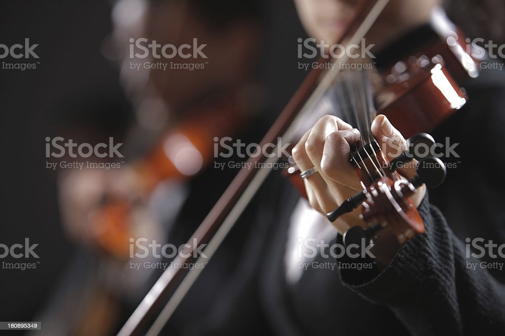 Classical music. Violinists in concert royalty-free stock photo